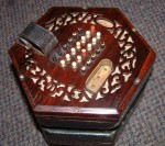 LACHENAL ENGLISH CONCERTINA, METAL BUTTONS, ROSEWOOD ENDS.